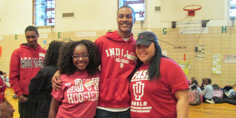Three students in IU gear smiling for the camera.